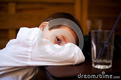 Sleepy head on table