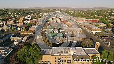 The sleepy town of Pendleton Oregon at sunrise on Sunday. Aerial perspective sliding right over downtown city skyline of Pendleton Oregon USA stock video