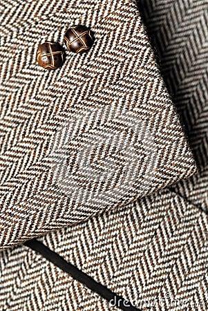 Sleeve of tweed brown jacket