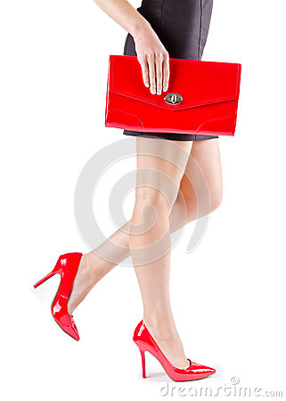 Free Slender Beautiful Womanish Feet In Red Shoes And Mini Bag Stock Photo - 28665150