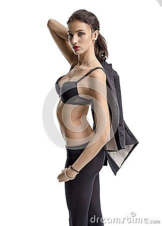 Free Slender Brunette Girl Removes A Business Suit Undressing Royalty Free Stock Image - 62925646