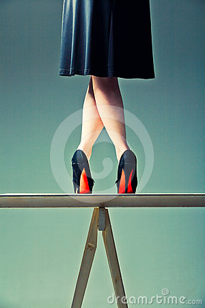 Slender female legs crossed on the table