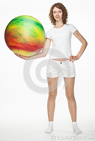 Slender girl with a fitball