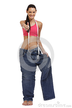Slender young lady on the large jeans after diet