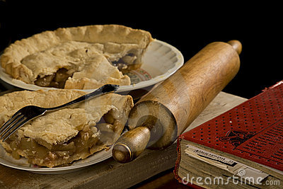 Slice of apple pie with fork.