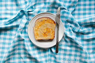 Slice of buttered toast on a plate