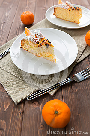 Slice Of Cake To The Mandarin Royalty Free Stock Photo - Image: 28368315