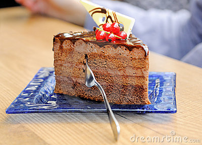 Slice of chocolate cake decorated with berries