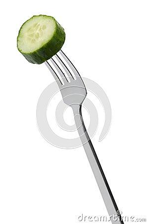 Slice of cucumber on fork