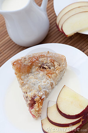 Slice of freshly baked rhubarb crumble with apple
