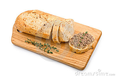 Slice of homemade bread with pate and herbs