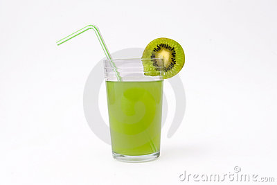 Slice of kiwi and glass of kiwi juice with straw