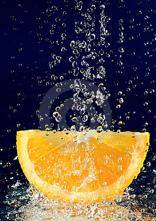 Slice of orange with water drops