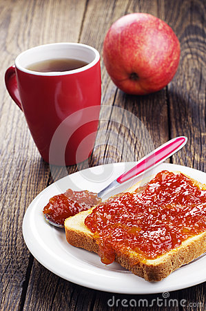 Slice toast bread with jam and tea