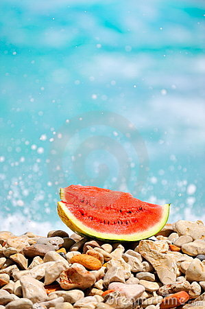 Slice Of Watermelon At Seashore Stock Image - Image: 10258731