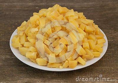 Sliced boiled potatoes, in the process of cooking salad. Natural and beneficial food concept Stock Photo