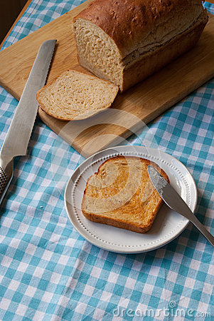 Sliced bread on blue gingham cloth