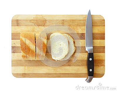Sliced bread and kitchen knife on cutting board