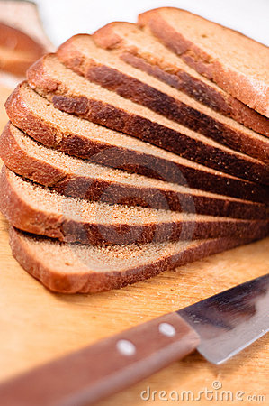 Free Sliced Bread On A Wooden Cutting Board And Knife Stock Images - 11153034