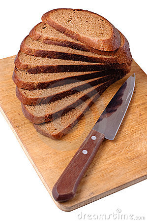Sliced bread on a wooden cutting board and knife