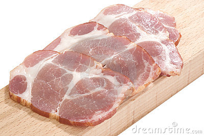 Sliced cooked pork neck on a cutting board