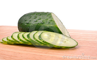 Sliced cucumber on the cutting board