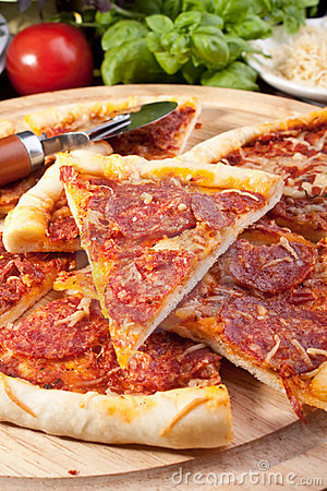 Sliced delicious pepperoni pizza and ingredients