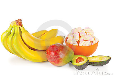 Sliced fresh avocado, mango, bananas and candies
