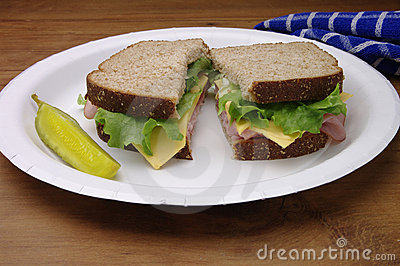Sliced Ham Sandwich on Paper Plate