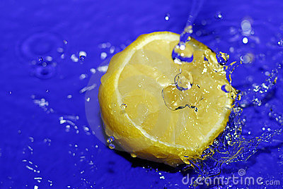 Sliced lemon in blue water
