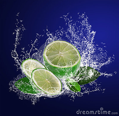 Sliced lime in water drops