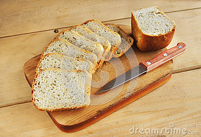 Sliced loaf on a wooden cutting board