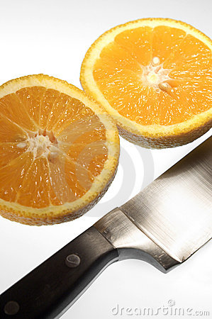 Sliced orange with knife