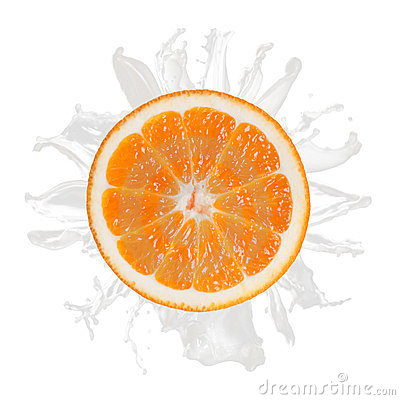 Sliced orange splash with milk isolated