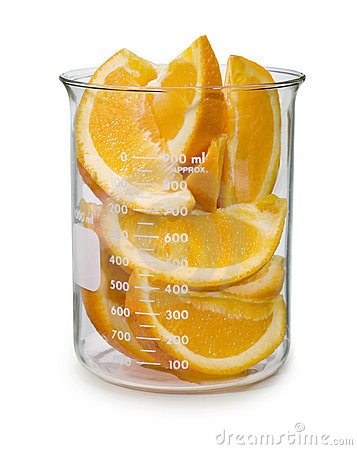Sliced Oranges In A Beaker