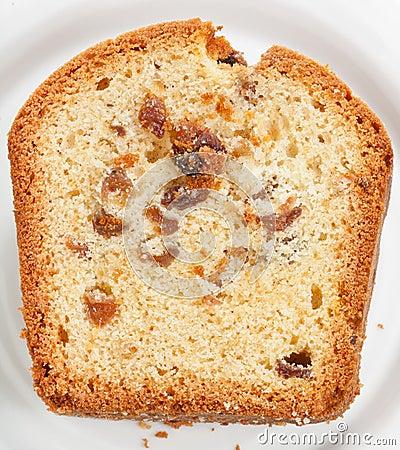 Sliced piece of cake with raisin