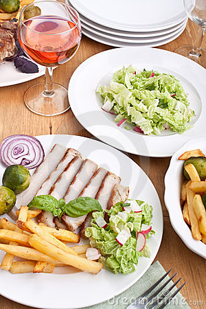 Sliced pork chops with fries