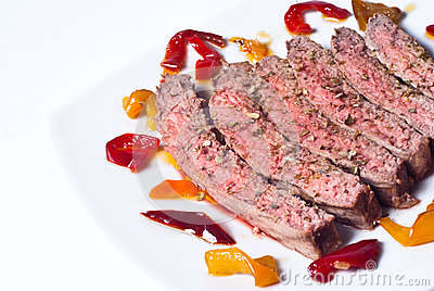 Sliced roast meat with pickled peppers