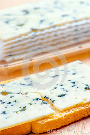 Sliced roquefort cheese