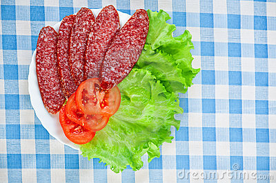 Sliced ​​smoked sausage, tomatoes,
