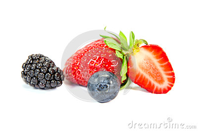 Sliced strawberry with bilberry isolated