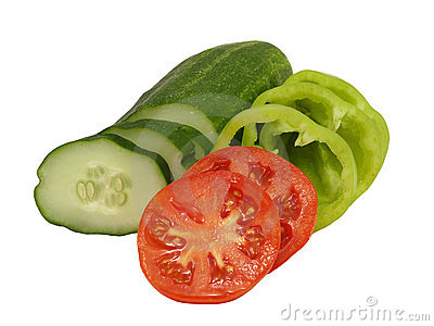 Sliced tomato, cucumber and green peppe.Isolated.