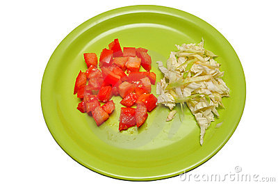 Sliced tomatoes on a plate top view