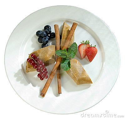 Slices of apple pie with cinnamon and berries