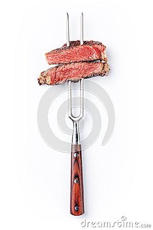 Slices of beef steak on meat fork