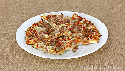 Slices and Bite of Meat Pizza