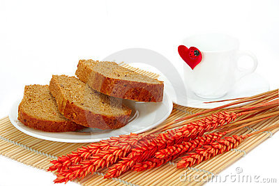 Slices of bread and empty cup