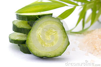 Slices of cucumber with sea salt isolated on white Stock Photo