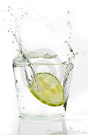 Slices Cucumber splashing into water