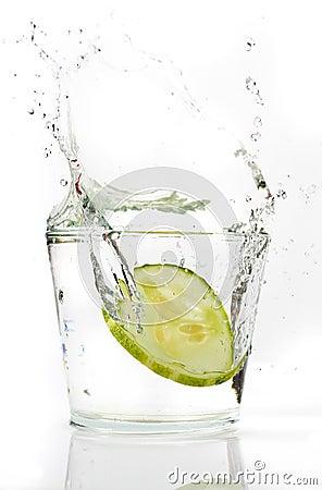 Slices Cucumber splashing into water